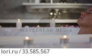 Caucasian woman taking bath in hotel. Стоковое видео, агентство Wavebreak Media / Фотобанк Лори