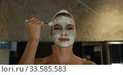 Купить «Caucasian woman putting on face mask in hotel», видеоролик № 33585583, снято 13 мая 2019 г. (c) Wavebreak Media / Фотобанк Лори