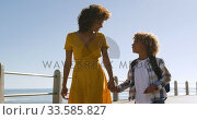 Купить «Mother and son spending time together at beach », видеоролик № 33585827, снято 14 июня 2019 г. (c) Wavebreak Media / Фотобанк Лори