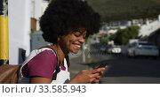Mixed race woman on smartphone on sidewalk. Стоковое видео, агентство Wavebreak Media / Фотобанк Лори