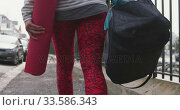 Купить «Caucasian woman going to the sports», видеоролик № 33586343, снято 18 сентября 2019 г. (c) Wavebreak Media / Фотобанк Лори