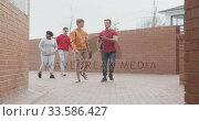 Купить «Students walking in their high school grounds», видеоролик № 33586427, снято 18 сентября 2019 г. (c) Wavebreak Media / Фотобанк Лори