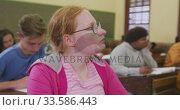 Купить «Student concentrating in high school class», видеоролик № 33586443, снято 18 сентября 2019 г. (c) Wavebreak Media / Фотобанк Лори