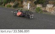 Купить «Disabled man riding a recumbent bicycle», видеоролик № 33586891, снято 16 апреля 2019 г. (c) Wavebreak Media / Фотобанк Лори