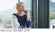 Купить «Business woman thoughtful looking through the window», видеоролик № 33587279, снято 9 ноября 2019 г. (c) Wavebreak Media / Фотобанк Лори