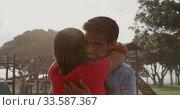 Купить «Young couple in love hugging», видеоролик № 33587367, снято 30 мая 2019 г. (c) Wavebreak Media / Фотобанк Лори