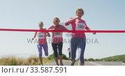 Купить «Athletics women arriving at finish line», видеоролик № 33587591, снято 30 января 2020 г. (c) Wavebreak Media / Фотобанк Лори