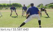 Baseball players stretching together. Стоковое видео, агентство Wavebreak Media / Фотобанк Лори