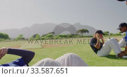 Baseball players doing sit ups at a playing field. Стоковое видео, агентство Wavebreak Media / Фотобанк Лори
