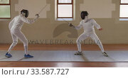 Fencer athletes during a fencing training in a gym. Стоковое видео, агентство Wavebreak Media / Фотобанк Лори