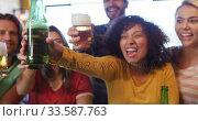 Купить «Friends at the bar in a pub having fun», видеоролик № 33587763, снято 15 ноября 2019 г. (c) Wavebreak Media / Фотобанк Лори