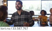 Купить «Friends at the bar in a pub during the day», видеоролик № 33587767, снято 15 ноября 2019 г. (c) Wavebreak Media / Фотобанк Лори