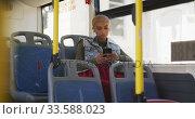 Купить «Mixed race woman taking the bus», видеоролик № 33588023, снято 10 января 2020 г. (c) Wavebreak Media / Фотобанк Лори