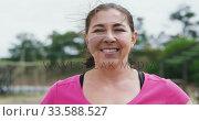 Купить «Caucasian woman looking at camera at boot camp», видеоролик № 33588527, снято 31 января 2020 г. (c) Wavebreak Media / Фотобанк Лори