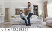 Купить «Father and son spending time together », видеоролик № 33588851, снято 24 января 2020 г. (c) Wavebreak Media / Фотобанк Лори