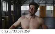 Portrait athletic Caucasian man smiling at the camera. Стоковое видео, агентство Wavebreak Media / Фотобанк Лори
