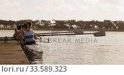 Купить «Male rower team getting ready to practice rowing on lake», видеоролик № 33589323, снято 27 ноября 2019 г. (c) Wavebreak Media / Фотобанк Лори
