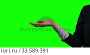 Focus on a side view holding her hand for a copy space with green screen. Стоковое видео, агентство Wavebreak Media / Фотобанк Лори