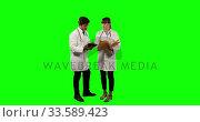 Купить «Front view of doctors checking their results on digital tablet with green screen», видеоролик № 33589423, снято 18 января 2019 г. (c) Wavebreak Media / Фотобанк Лори