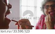 Купить «A senior african american woman spending time at home taking care of herself  social distancing in q», видеоролик № 33590123, снято 12 ноября 2019 г. (c) Wavebreak Media / Фотобанк Лори