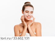Купить «Beautiful woman with facial white mask on white background.», фото № 33602131, снято 26 мая 2020 г. (c) easy Fotostock / Фотобанк Лори