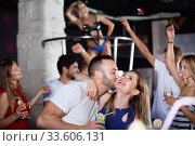 couple of smiling people together in the night club with drinks. Стоковое фото, фотограф Яков Филимонов / Фотобанк Лори
