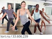 Купить «People dancing lindy hop during group training», фото № 33606239, снято 30 июля 2018 г. (c) Яков Филимонов / Фотобанк Лори