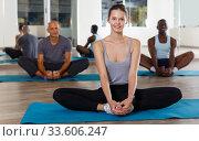 Slim girl making yoga meditation in lotus pose. Стоковое фото, фотограф Яков Филимонов / Фотобанк Лори