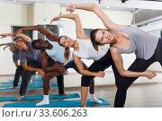Купить «Nice people exercising during yoga class», фото № 33606263, снято 30 июля 2018 г. (c) Яков Филимонов / Фотобанк Лори