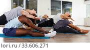 Купить «females and males doing stretching workout in pairs», фото № 33606271, снято 30 июля 2018 г. (c) Яков Филимонов / Фотобанк Лори