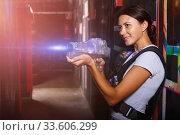 Ordinary girl took aim during laser tag game. Стоковое фото, фотограф Яков Филимонов / Фотобанк Лори