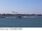 Ударные вертолёты Ми-28 пролетают на параде в честь Дня ВМФ в Севастопольской бухте, Крым (2019 год). Редакционное фото, фотограф Николай Мухорин / Фотобанк Лори