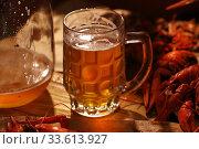 Купить «Crayfish with beer on a wooden table», фото № 33613927, снято 20 апреля 2020 г. (c) Марина Володько / Фотобанк Лори