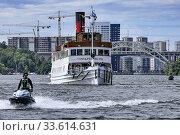 Купить «STOCKHOLM, SWEDEN A ship enters the Hammarbyslussen locks between the Baltic Sea and Lake Mälaren, a 2 meter difference, and a jetski.», фото № 33614631, снято 5 июля 2017 г. (c) age Fotostock / Фотобанк Лори