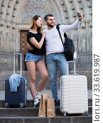 female and male standing with baggage at street and taking selfie. Стоковое фото, фотограф Яков Филимонов / Фотобанк Лори