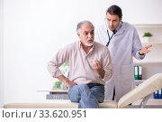 Купить «Young male doctor and old patient in antismoking concept», фото № 33620951, снято 9 сентября 2019 г. (c) Elnur / Фотобанк Лори