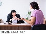 Купить «Disabled man consulting judge for damages litigation», фото № 33621687, снято 6 мая 2019 г. (c) Elnur / Фотобанк Лори
