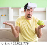 Young man with virtual reality goggles. Стоковое фото, фотограф Elnur / Фотобанк Лори