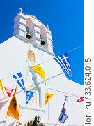 Купить «Greek church drcorated by flags», фото № 33624015, снято 22 апреля 2018 г. (c) Роман Сигаев / Фотобанк Лори