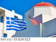 Купить «Church and national greek flag», фото № 33624023, снято 22 апреля 2018 г. (c) Роман Сигаев / Фотобанк Лори