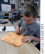 Купить «Middle School Student Practicing Drawing With India Ink in Art Class, Wellsville Secondary School, Wellsville, New York.», фото № 33625551, снято 8 октября 2019 г. (c) age Fotostock / Фотобанк Лори