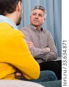 Купить «Adult father and son solve problems», фото № 33634871, снято 27 мая 2020 г. (c) Яков Филимонов / Фотобанк Лори
