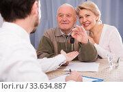 Купить «Old man and mature woman signing contract car lease», фото № 33634887, снято 5 июня 2020 г. (c) Яков Филимонов / Фотобанк Лори