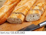 French loaves with chopped slices. Стоковое фото, фотограф Яков Филимонов / Фотобанк Лори