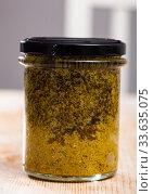 Купить «Organic pesto sauce in glass jar on wooden surface», фото № 33635075, снято 28 мая 2020 г. (c) Яков Филимонов / Фотобанк Лори