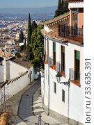 Empty narrow street of Granada resort town. Spain (2019 год). Стоковое фото, фотограф Alexander Tihonovs / Фотобанк Лори