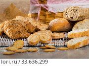 Wheat and grain baguettes, croissants and biscuits on wicker mat. Стоковое фото, фотограф Яков Филимонов / Фотобанк Лори