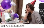 Купить «Woman celebrating birthday from home», видеоролик № 33638239, снято 19 апреля 2020 г. (c) Сергей Петерман / Фотобанк Лори