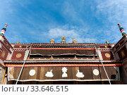 Купить «Upward view of tibetan style building, kumbum monastery sutra printing house, specializing in the imprint of tibetan buddhism classics, qinghai province, China», фото № 33646515, снято 7 июля 2020 г. (c) easy Fotostock / Фотобанк Лори