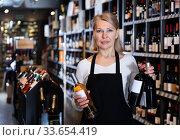 Купить «Adult female giving recommendation about wine», фото № 33654419, снято 3 июня 2020 г. (c) Яков Филимонов / Фотобанк Лори